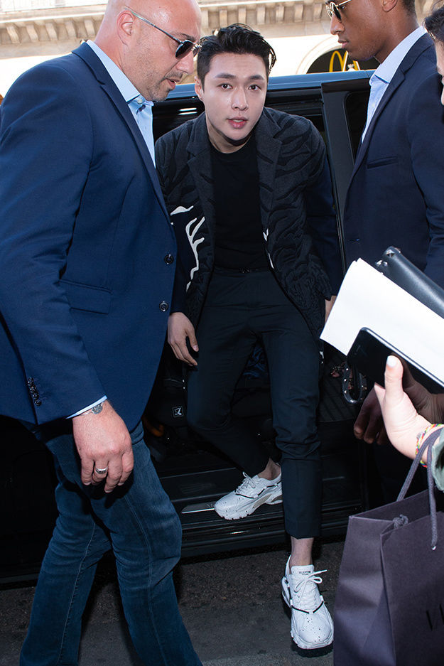 8da02f129387 Lay Zhang wearing a Valentino look from the Fall Winter 2018-19 Collection  to the Valentino Men s Spring Summer 2019 Fashion Show on June 20th 2018.